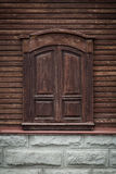Old wooden window with carved wooden ornaments. Closed window. Royalty Free Stock Photos