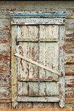 Old wooden window with closed shutters Stock Photos