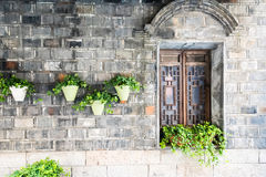 old wooden window and flower pot Stock Photos
