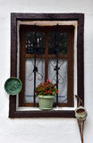 Old wooden window frame with hanged pottery. Old brown wooden window frame with hanged pottery Stock Photo