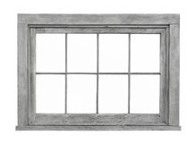 Old wooden window frame isolated. Old gray weathered wooden window frame with eight panels.  Isolated on white Royalty Free Stock Photography