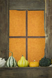 Old Wooden Window with Gourds Royalty Free Stock Photo
