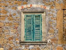 Old wooden window with green shutters royalty free stock image