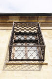 Old wooden window with grill Royalty Free Stock Image