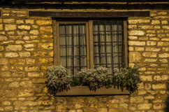 Old wooden window in a historic building, characteristic stone f Royalty Free Stock Photos