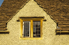 Old wooden window in a historic building, characteristic stone f Stock Photography