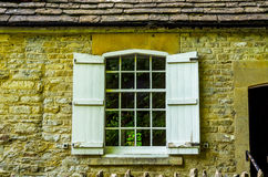 Old wooden window in a historic building, characteristic stone f Stock Photo