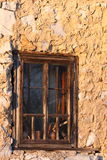Old wooden window with iron bars Royalty Free Stock Photos