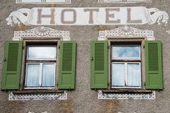 Old wooden window mountain hotel exterior view Stock Photography