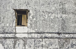 Old wooden window with old , dirty, dark and black grainy wall Royalty Free Stock Photo