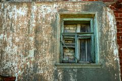Old wooden window. Laid with bricks and boards Royalty Free Stock Photos