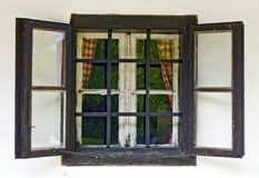 Old wooden window with open outer wings Royalty Free Stock Photo