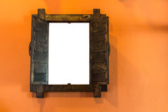 Old wooden window on orange wall with empty space. Inside Stock Images