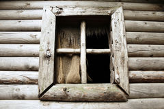 Old wooden window with a ragged burlap curtains as the background. Image Stock Photography