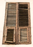 Old wooden window with shutters Royalty Free Stock Photo