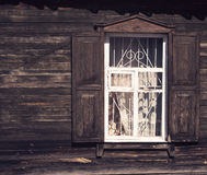 Old wooden window with shutters and casings on the old wooden bo Royalty Free Stock Photo