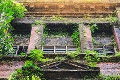 Old wooden window shutters in down town, Yangon, Myanmar stock images