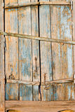 Old wooden window shutters with peeling off paint and rusty Stock Photo