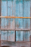 Old wooden window shutters with peeling off paint and rusty Royalty Free Stock Images