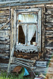The old wooden window in village, Poland. Old wooden window somewhere in old epty village Stock Image