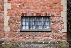 Old wooden window in a weathered brick wall in an old manor house royalty free stock photo