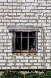 An old wooden window on the white brick wall of the house royalty free stock photos