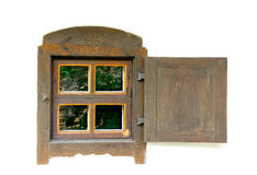 Old wooden window on a white wall. Stock Photo