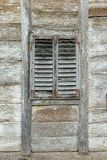Old wooden window with wooden blinds. On an abandoned wooden house Royalty Free Stock Images