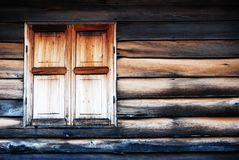 Old wooden window on the wooden wall. Picture with copy space. Old wood background and texture Stock Image
