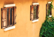 Old Wooden Window on Yellow Wall. Perspective Stock Images