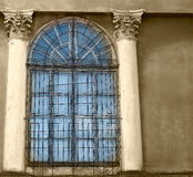 Old wooden windows with concrete walls and columns, sepia Royalty Free Stock Photos