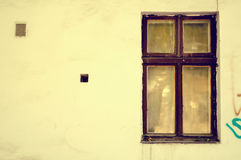 Old wooden windows frame on cement cracked wall Royalty Free Stock Photography