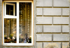 Old wooden windows frame on cement cracked wall Stock Photos