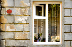 Old wooden windows frame on cement cracked wall Stock Image