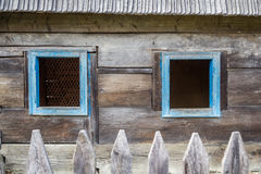Old wooden windows. Old wooden house from Maramures, one of the better-known regions of Romania, with autonomous traditions since the Middle Ages - but still not Stock Images