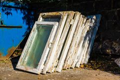 Old wooden windows in the trash, looking for replacements for new ones stock photos