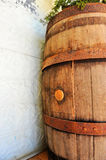 Old wooden wine barrel. An old wooden wine barrel closes wall Royalty Free Stock Photography