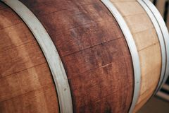 Old wooden wine barrel with iron hoops. Close up stock photography