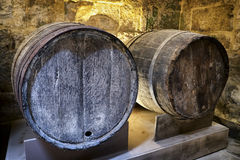 Old wooden wine cask. At a farmhouse stock image