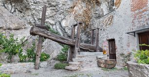 Vintage agricultural equipment. Old wooden wine press. Old wooden wine press from 1759 at the Hermitage of Santa Caterina del Sasso on Lake Maggiore, Italy stock photo