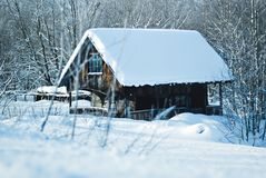 Wooden winter cabin loct in forest royalty free stock photos