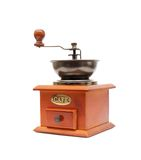 Old wooden worm eaten coffee mill Stock Images