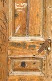 Old wooden house door in Baku. Old wooden yellow house door in Baku royalty free stock images