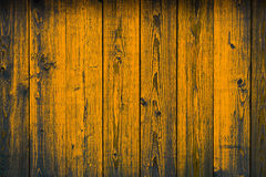 Old wooden yellow painted peeling off planks, texture background stock photos