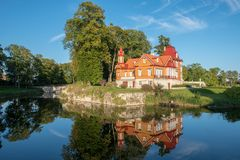 Old woodwn house reflected in the moat royalty free stock image
