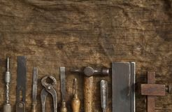 Old Woodwork Tools. On grungy rag background royalty free stock photo