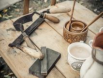 Old woodworking hand tool drawknife, drawshave, drawing knife, shaving knifewooden in a carpentry workshop on dirty royalty free stock image