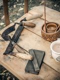 Old woodworking hand tool drawknife, drawshave, drawing knife, shaving knifewooden in a carpentry workshop on dirty stock photo