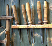 Old woodworking tools on wall. Very old rusty woodworking tools on wall royalty free stock photo