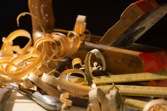 Old woodworks tools: wooden planer, hammer, chisel in a carpentr Stock Image